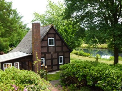 Photo for Holiday house on a large plot with swimming pond, secluded location