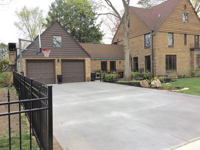 Spacious Driveway houses up to 4 cars and has basketball court