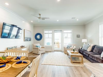 Photo for Luxurious, two-story cottage near the beach w/ a full kitchen & shared pool