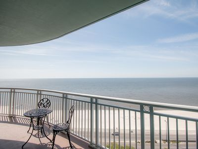 Photo for Spacious Beach View Condo w/ WiFi, Balcony, Resort Pool & Gym Access