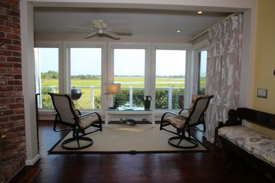 In addition to the living room, there is another sitting area off of dining room
