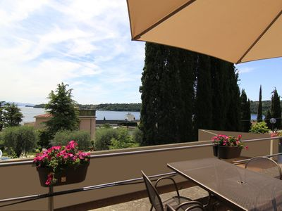 Photo for Residence del Golfo with lake view, terrace, A / C, wi-fi, parking space