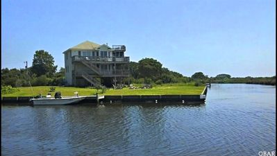"""Photo for """"The best canal front home in the OBX""""  home of the wild horses 4 mins to beach"""