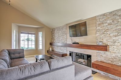 The spacious living room features a 55-inch flat-screen TV.