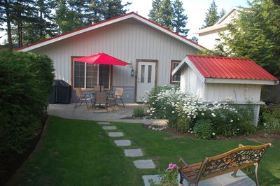 Cozy cottage with private driveway and parking.  Sunny patio with BBQ and Table.