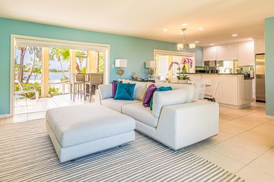 Living area and kitchen opens out to the two-story screened lanai.