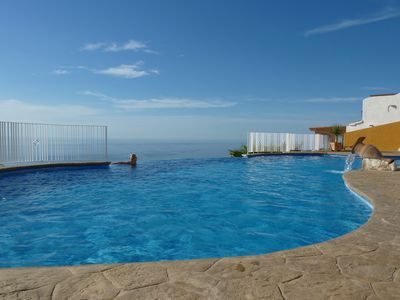 Photo for Penthouse apartment with stunning sea views, 2 infinity pools, WiFi