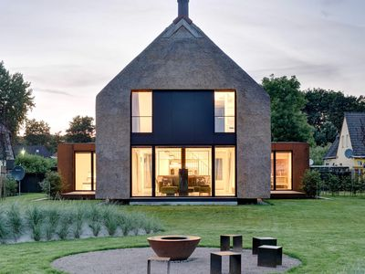 Photo for Individual, freestanding architect house with all comfort, fireplace, sauna, large garden, view .... - Seestück Prerow