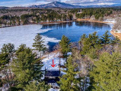 Photo for NEW LISTING! Lakefront home with private beach, and dock, close to skiing!