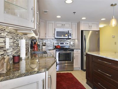 Photo for FREE DAILY ACTIVITIES! LINENS INCLUDED*!  Beautifully decorated, direct oceanfront, 3 bedroom, 2 bath condo is a vacationer's dream!