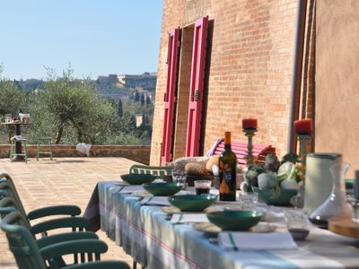 Photo for SANTA10- A hamlet sits on a hill of olive trees and vineyard facing Siena
