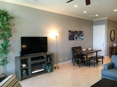 """55"""" TV, Electric Fireplace, Dining can accommodate 10 with 4 chairs & 2 benches"""