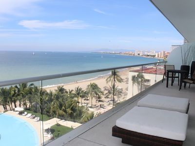 Photo for LUXURY 4 bedroom condo, beachfront,  pool, gym spa