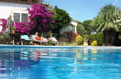 Relax by the large heated salt water pool
