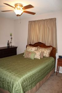 Antique queen size bed, dresser, nightstand, and black out curtains.