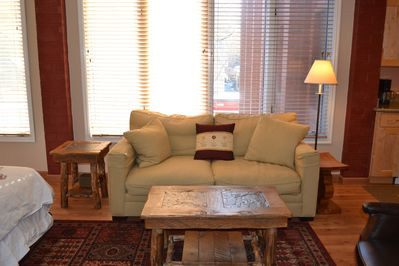 Living Room w/ restoration Hardware couch and hand made log end and coffee table