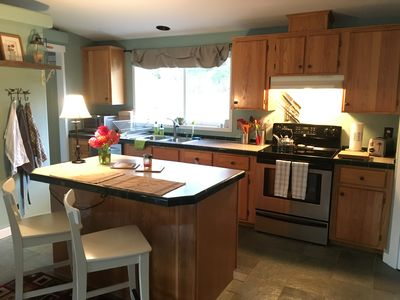 A well-stocked kitchen with new stainless appliances. Pantry items supplied