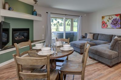 Dining area; seats for 4 at the dining table and 2 at the breakfast bar