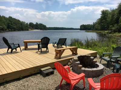 Relax and sunbath on this large platform deck or enjoy the fire pit at night