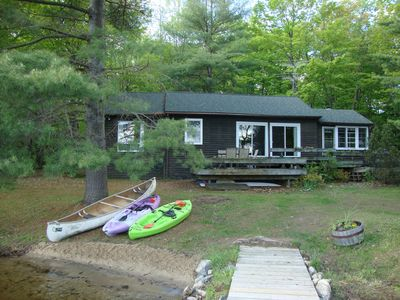 Cottage from dock, southern exposure. Sunny decks. Canoe, kayaks included.