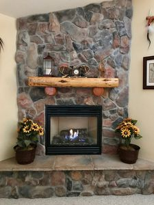 The cheery fireplace will warm you up on a chilly evening.