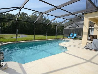 Photo for 4 Bedroom Disney Orlando Private Pool Home with Beautiful Water View, Hot Tub & Outdoor Deck!