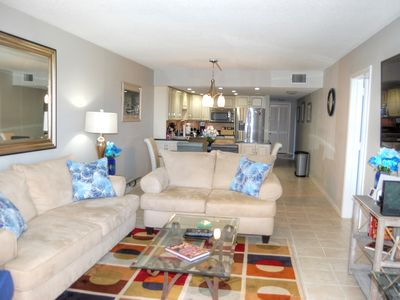 Photo for Just steps from the beach in this spacious, beautifully furnished condo