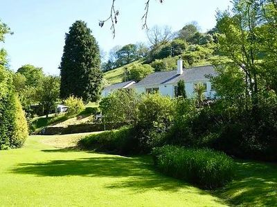 Photo for Luxurious, tranquil retreat, huge gardens and river, near beaches.
