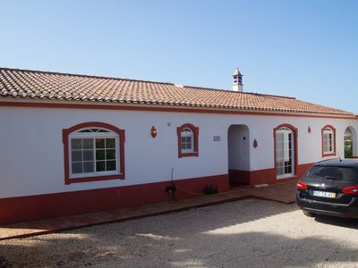 Photo for Nice villa with salt water pool, surrounded by gardens and farm of orange trees