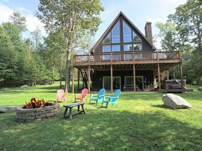 Photo for Mountaintop chalet with lake access, hot tub, fire pit and horseshoe pits!