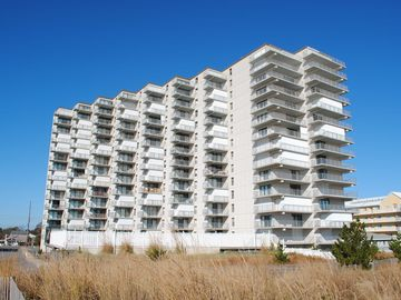 stylish, upscale 2 bedroom oceanfront condo designed for sophisticated adults with free wiFi, an outdoor pool, and a gorgeous ocean view located uptown just steps to the beach!