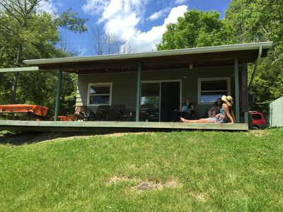 Quiet & Relaxing w/ a Wonderful Covered Lakefront Porch & plenty of rockers