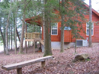 secluded cabin overlooking large private pond stocked with bass and bluegill