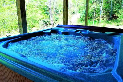 Relaxing hot tub with mountain and river views