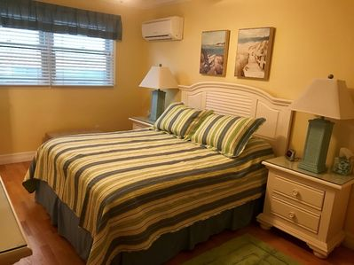 The master bedroom has generous clothing storage , a tv, and master bedroom bath
