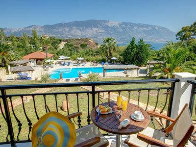 Photo for Spacious apartments with breakfast, pool, tennis court and uncut sea views.