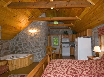 View of cabin with 15' vaulted pine plank ceiling.