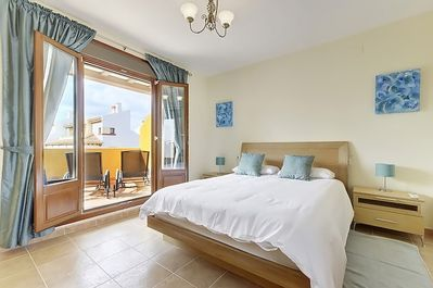 The master bedroom has access to two balconies