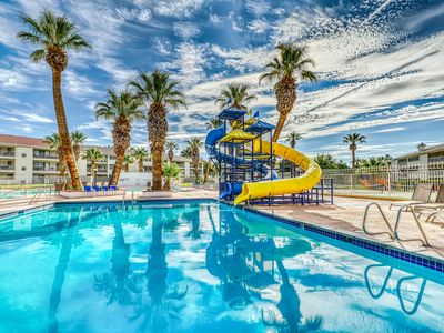 Photo for NEW LISTING! Family condo w/ private hot tub, grill & shared pools/splash pad