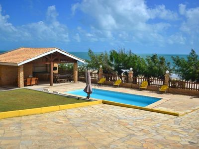 Photo for Luxury beach house with pool, terrace by the sea.