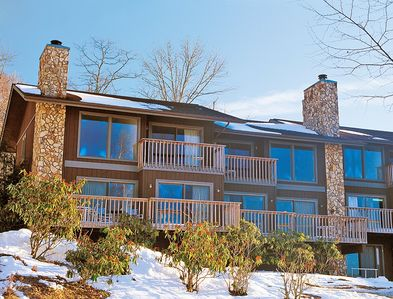 A street view of the Blue Ridge Village Resort unit covered in snow.