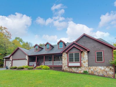 Lake access home on 2 acres, includes a hot tub, several fun game tables, & a fire pit!