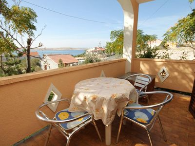 Photo for One bedroom apartment with terrace and sea view Vidalići, Pag (A-9382-c)