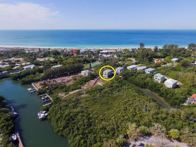 Photo for Large 4 bedroom single family house with dock across from beach