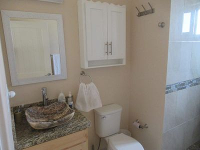 Photo for Roof Top Unit, with Ocean View.  Access to a large pool.  Steps to the Beach.