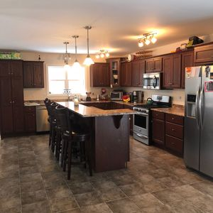 huge open kitchen - with island that sits four on Raised level