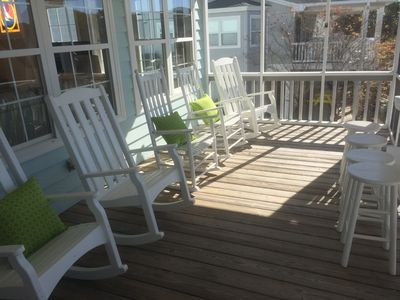 Our charming front porch has rockers and a little bar area for a snack or drink!