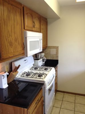 Well appointed Kitchen with tiled floor and Granite Countertops