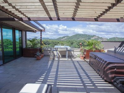 Photo for Walk to Everything, Luxury Penthouse, Rooftop Living, Kitchen space w/Hot Tub