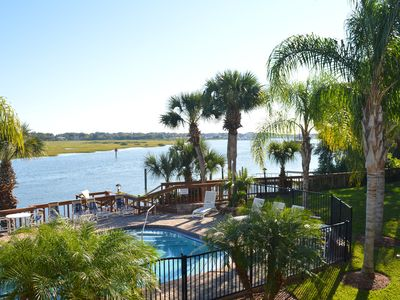 Photo for Waterfront Condo with pool & dock close to historic district